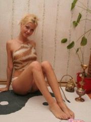 Blonde Teen Girl Taking Her Clothes Off - Picture 1